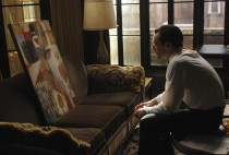 Don looking at painting in Mad Men